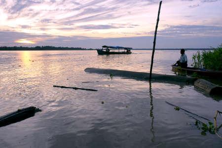 Amazon river landscape   people at sunrise, near Leticia  Colombia-Brazil-Peru border triangle