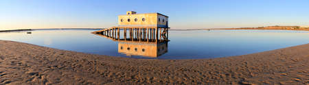 ria: Old historic life-guard bulding in Fuseta, at Ria Formosa conservation park, Algarve  Portugal