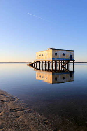 ria: Old historic life-guard bulding in Fuseta, at Ria Formosa conservation park, Algarve. Portugal