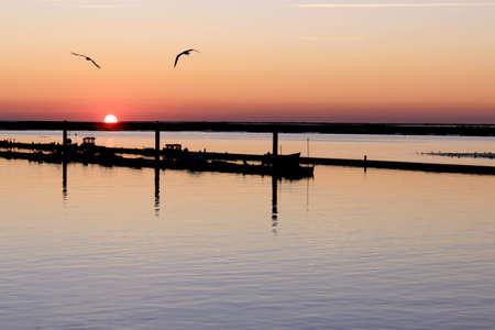 region of algarve: Sunrise in Ria Formosa, natural conservation region in Algarve, Portugal.