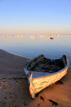 formosa: Old boat at sunset in Ria Formosa, natural conservation park, Algarve  Portugal Stock Photo