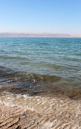 Dead Sea coastline, whit salt crystals and formations in the sand  Jordan photo