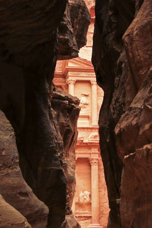 Rosy red walls of the Siq canyon, leading to the Treasury in Petra, Jordan Stock Photo - 16417331