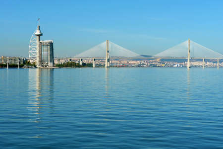 View from river Tagus of Lisbons Nations park and Vasco da Gama Bridge, Portugal