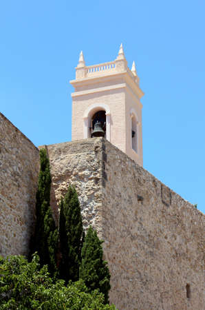 fortified wall: ancient fortified wall and the tower bell of parish church