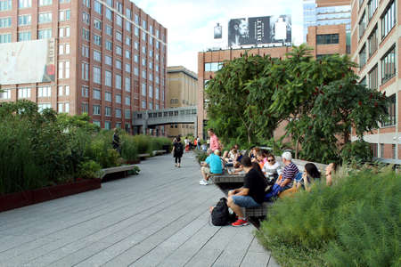 NEW YORK CITY - SEPTEMBER 03  People at High Line Park in NYC on September 03th, 2013  The High Line is a public park built on an historic freight rail line elevated above the streets on Manhattan West Side