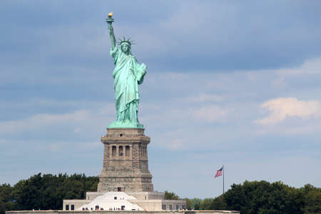 The Statue of Liberty  Liberty Enlightening the World , a colossal neoclassical sculpture on Liberty Island in the middle of New York Harbor, Manhattan  The statue is of a robed female figure representing Libertas, the Roman goddess of freedom, who bears  photo