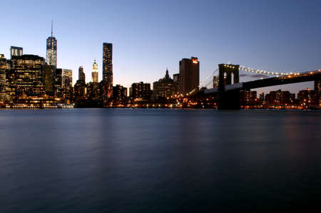 Twilight as the sun sets over Lower Manhattan. Famous New York landmarks  photo