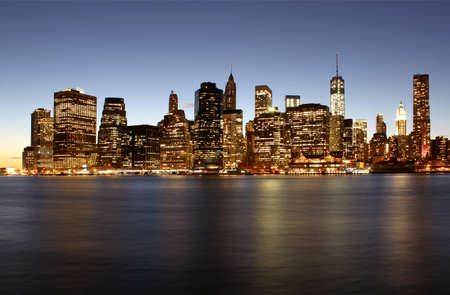 Twilight as the sun sets over Lower Manhattan  Famous New York landmarks photo