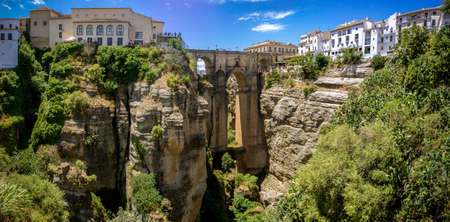 Ronda Panoramic view over Puente Nuevo   New Bridge   The newest and largest of three bridges that span the 120-metre  390 ft -deep chasm that carries the Guadalevín River and divides the city of Ronda, in southern Spain  Built between 1759-1793, the arc photo