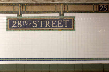 New York City Station subway 28th Street sign on tile wall. The NYC Subway is one of the oldest and most extensive public transportation systems in the world, with 468 stations.