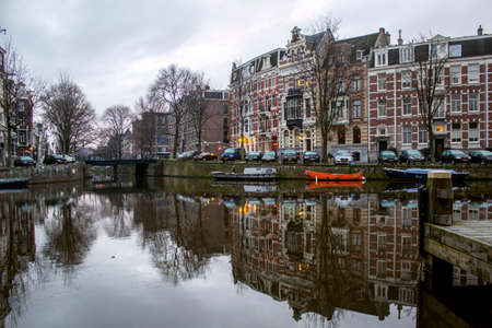dutch canal house: Early morning winter view on one of the Unesco world heritage city canals (Singelgracht and Leidsegracht) of Amsterdam, The Netherlands.