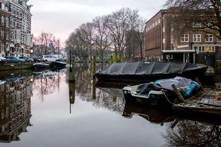 dutch canal house: Early morning winter view on one of the Unesco world heritage city canals (Singelgracht) of Amsterdam, The Netherlands.