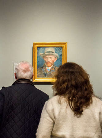 van gogh: AMSTERDAM, NETHERLANDS - FEBRUARY 08: Visitors at Rijksmuseum admiring a Vincent van Gogh, Self-portrait, on February 08, 2015 in Amsterdam. The Rijksmuseum is located at the Museum Square, and first opened its doors in 1885.