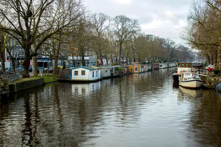 dutch canal house: Early morning winter view on canals of Amsterdam, The Netherlands. Stock Photo