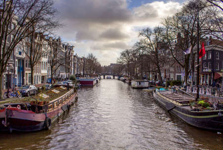 dutch canal house: View of one of the Unesco world heritage famous city canals (Prinsengracht) of Amsterdam, The Netherlands.