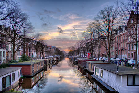 dutch canal house: View of famous city canals (gracht) of Amsterdam, The Netherlands.