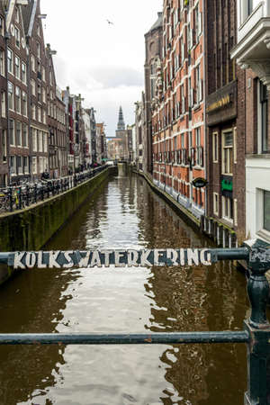 dutch canal house: Morning winter view on one of the heritage city canals of Amsterdam, Netherlands.