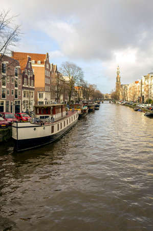 westerkerk: View on one of city canals (Prinsengracht) of Amsterdam whit The Westerkerk Church in the background, The Netherlands.