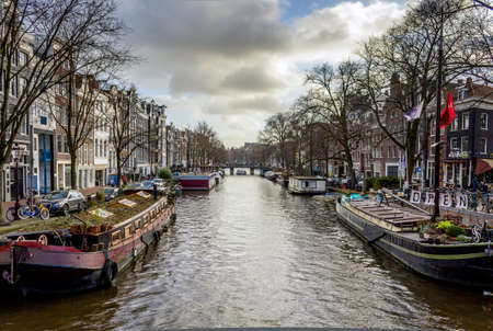 dutch canal house: View of one of the famous city canals (Prinsengracht) of Amsterdam, The Netherlands. Editorial