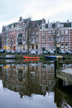 dutch canal house: Early morning winter view on  city canals (Singelgracht and Leidsegracht) of Amsterdam, The Netherlands.