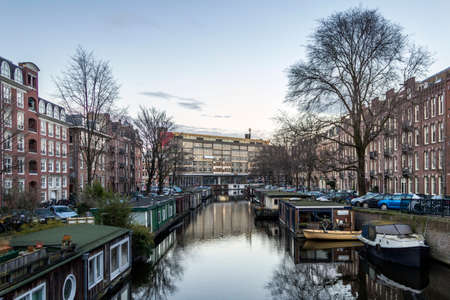 dutch canal house: View on one of the heritage city canals of Amsterdam, Netherlands.