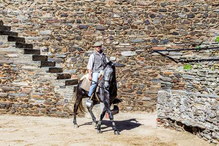 bullfighting: MONSARAZ - APRIL 06: Horse training in Alentejo Town of Monsaraz castle inner space (used as a traditional bullfighting arena), on April 06, 2014, in Monsaraz, Portugal. Editorial