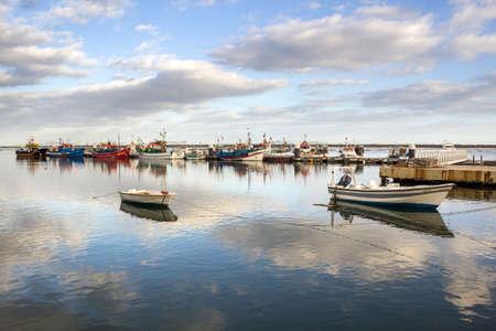 region of algarve: Ria Formosa natural conservation region fishing boat port in St.Luzia Algarve. Portugal.