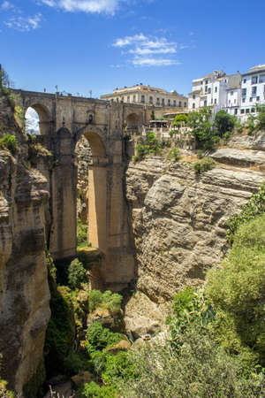 chasm: Ronda Panoramic view over Puente Nuevo, New Bridge The newest and largest of three bridges that span the 120-metre deep chasm that carries the Guadalevín River and divides the city of Ronda, in southern Spain. Built between 1759-1793, the architect was J Stock Photo