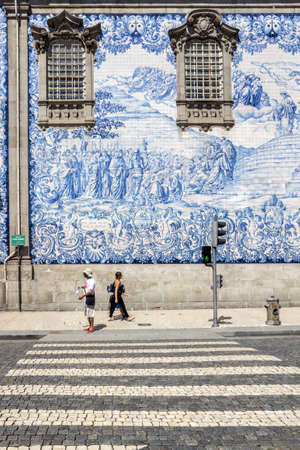 carmo: Carmo Church side wall detail, completely covered in traditional blue and white ceramic tile panels called Azulejos. in Porto. Portugal Stock Photo