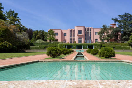 the throughout: PORTO, PORTUGAL - JULY 05, 2015: Serralves gardens, a green park that extends over 18 hectares involving the Museum of Contemporary Art Serralves Foundation. Throughout the park works of contemporary art are exhibited alongside the typical flora of the no