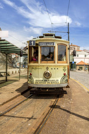electrico: PORTO, PORTUGAL - JULY 04, 2015: Famous Heritage yellow tram, called Electrico in the center of Porto, On July 04, 2015 in Porto, Portugal.