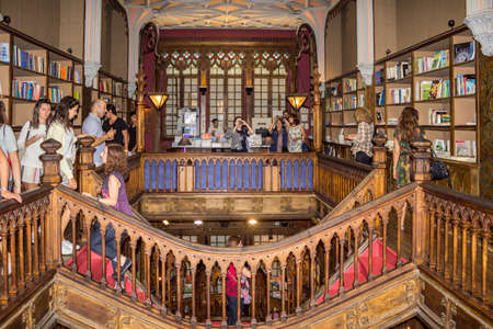 PORTO, PORTUGAL - JULY, 04: People visiting famous bookstore Livraria Lello, establishment in 1919 it is one of the oldest bookstores in Portugal, on July 04, 2015 in Porto.