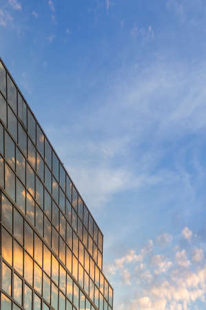 reflex: Sunset soft cloudy sky and reflex in modern building graphic detail background