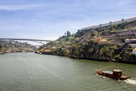 rabelo: Panoramic view of Douro River, Porto landscape and tradicional Rabelo boats, on a summer day, Portugal. Stock Photo