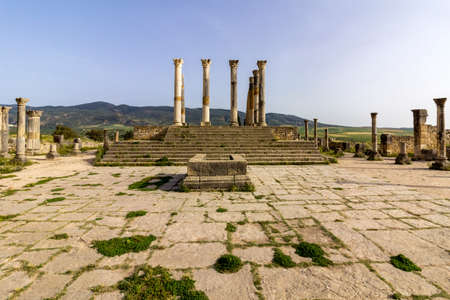 Capitoline Temple at archaeological Site of Volubilis, ancient Roman empire city,  located in Morocco near Meknes. Stock Photo