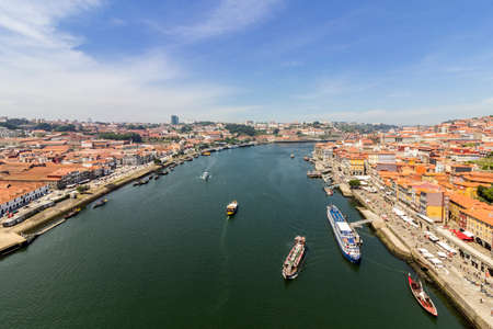 Porto landscape view over Douro River and turistic boats, on a summer day, Portugal.