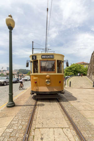 PORTO, PORTUGAL - JUNE 25, 2017: Famous Heritage yellow tram, called Electrico in the center of Porto, On June 25, 2017 in Porto, Portugal.