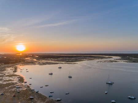 formosa: Sunrise aerial seascape, in Ria Formosa wetlands natural park, shot at 60m altitude over Cavacos beach. Algarve. Portugal