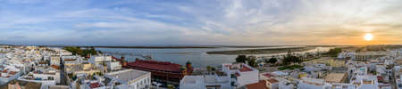 formosa: Sunset aerial cityscape in Olhao, Algarve fishing village view of ancient neighbourhood of Barreta, and its traditional cubist architecture. Portugal. Stock Photo