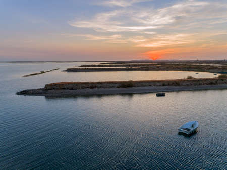 Sunset aerial seascape view of Olhao salt marsh Inlet, waterfront to Ria Formosa natural park. Algarve. Portugal. Stock Photo