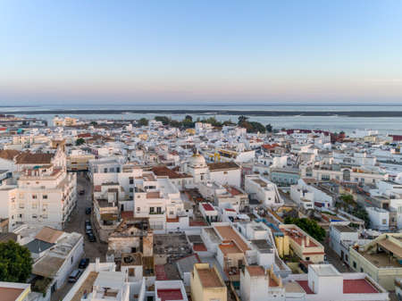 formosa: Sunset aerial cityscape in Olhao, Algarve fishing village view of ancient neighbourhoods of Barreta and Levante, and its traditional cubist architecture. Portugal. Stock Photo