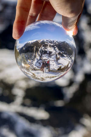 Roc Del Quer trekking trail observation deck, reflection view through crystal ball, Principality of Andorra. Stock Photo