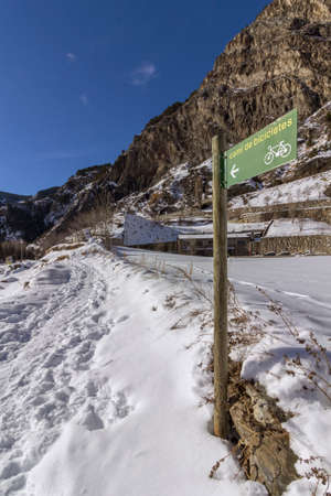 Winter pyrenes landscape near Village of Canillo, trekking and cycling trail. Principality of Andorra. Stock Photo