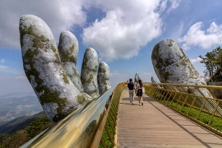 "Da Nang, Vietnam - October 31, 2018: Tourists in Golden Bridge known as ""Hands of God"", a pedestrian footpath lifted by two giant hands, open in July 2018 at Ba Na Hills in Da Nang, Vietna 報道画像"