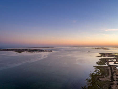 Algarve sunset seascape at Ria Formosa wetlands reserve, southern Portugal, famous nature destination.