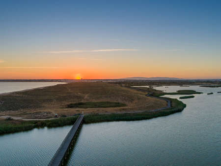 Aerial sunset seascape of Salgados beach and lagoon in Albufeira, Algarve tourism destination region, Portugal. 版權商用圖片