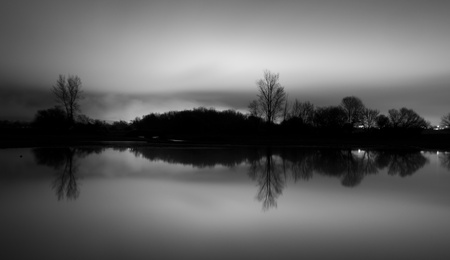 reflections in black and white. pantano de santillana. manzanares el real, madrid