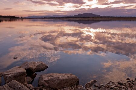 sunset on the lake, calm water creating a very attractive mirror. Stock Photo - 11295937