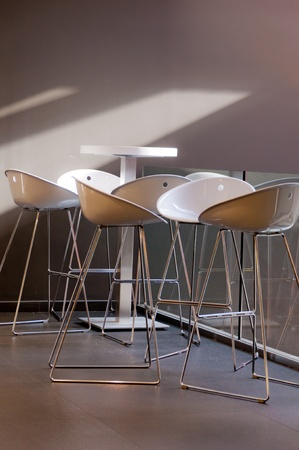 White plastic chairs and aluminum, illuminated by a beautiful natural light